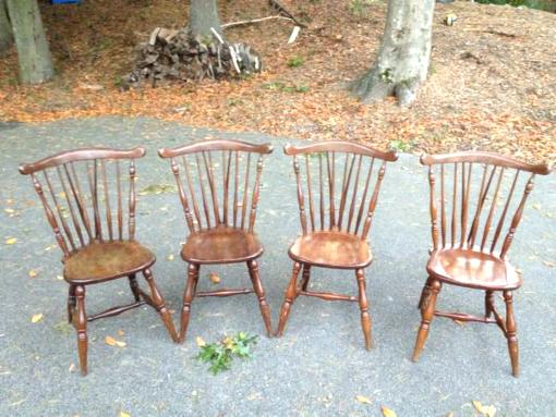 Set of four solid wood spindle chairs - $50